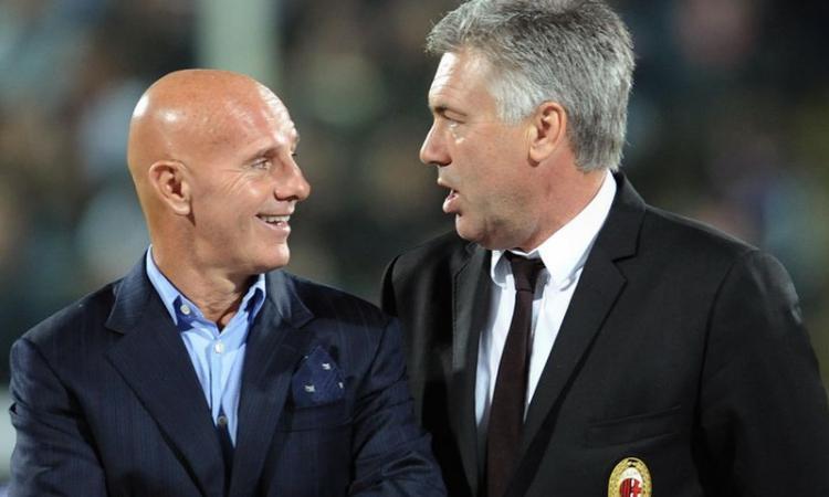 Arrigo Sacchi con Carlo Ancelotti. Entrenador del AC Milán